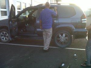 Policeman dusting car for fingerprints!!
