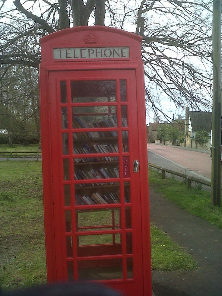 New use for telephone booth in Cambridge!! , local community library, Very creative!!