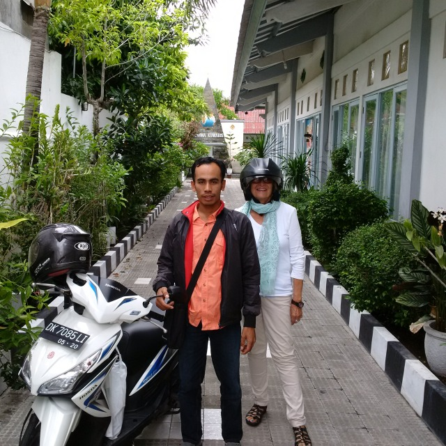 That's me under the head gear! With my taxi motor-scooter driver in Bali!