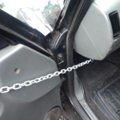 Chain on taxi door to stop being blown off by the wind!