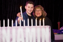 With Ben at the Bar Mitzvah; young man lighting the candles!