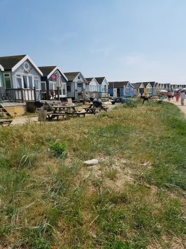 Beach huts by the sea that people pay 300 thousand pounds for!