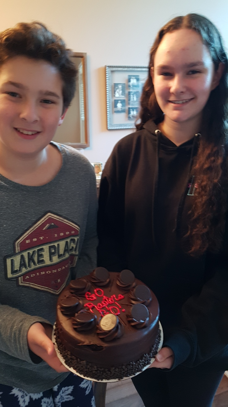 Ben and Megan, my grandkids, with their Raptor's Cake for the Basketball Championships